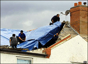 Plastic sheeting added to the roof of a house