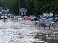 Cars struggle through floodwater