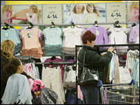 A woman shopping for clothes in Tesco