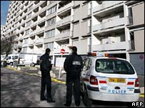 Police outside a housing estate when Ilan Halimi is believed to have been held