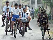 Tamil students cycle to schools as soldiers keep security in Jaffna 