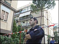 Police surround a flat on the outskirts of Rome