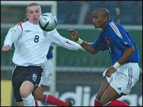 England's Grant Leadbitter and Yassin Moutaouakil of France