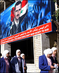 "Poster reading: ""President Bashar al-Assad and the Syrian people don't bend except to God"""