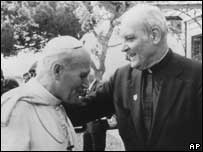 File photograph of Pope John Paul II, left, and Archbishop Marcinkus
