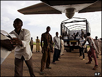 French food aid is unloaded in Maradi, Niger, on 30 July