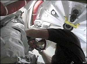 Astronauts prepare for spacewalk (pictures from Nasa TV)