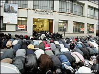 French Muslims pray in front of Adda Wa mosque in Paris
