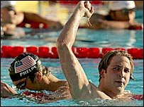 Ian Crocker celebrates victory over Michael Phelps