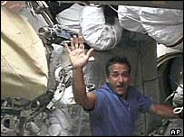 Mission specialist Charles Camarda waves from the mid-deck of the shuttle Discovery