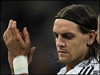 Woodgate salutes the fans after his substitution