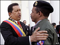 Venezuela's President Hugo Chavez speaks with an army commander at the National Assembly - File photo