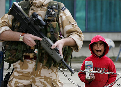 A boy cries next to a British soldier in Kabul, Afghanistan