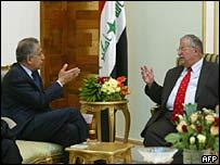 Iraqi President Jalal Talabani (R) talks to US ambassador to Iraq Zalmay Khalilzad