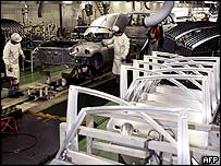Workers and steel car doors in a Japanese factory