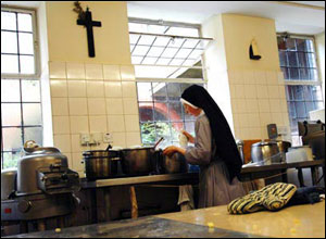 Sister Catherine preparing lunch in the kitchen