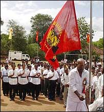 A Tamil Tiger supporter with the rebel flag during a rally