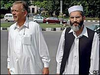 NWFP Finance Minister Siraj-ul Haq, right, and Law Minister Malik Zafar Azam arrive for the hearing