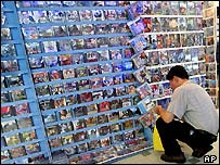 A Malaysian looks at a software disc for sale at a shopping mall where many of them are pirated in Kuala Lumpur, Malaysia