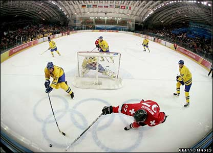 The ice-hockey match between Sweden (in yellow) and Switzerland (in red) in Turin