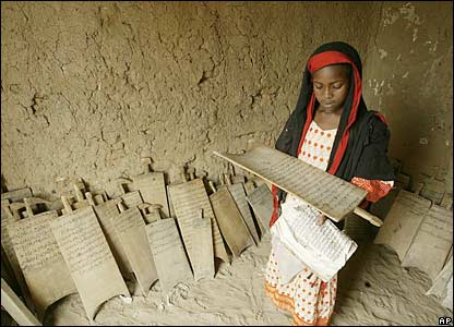 A girl in Chad reads the Qur'an