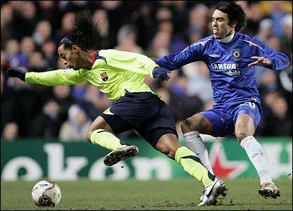 Barcelona's Brazilian star Ronaldinho takes on Chelsea's Paulo Ferreira