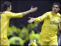 Riquelme (right) celebrates opening the scoring