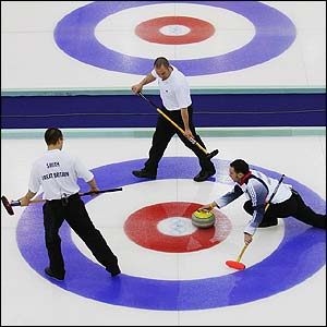 Britain's men's curlers in actionn against Finland