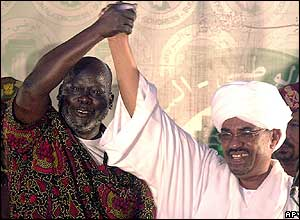 John Garang (l) with President Omar al-Bashir (r)