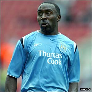 Darius Vassell in action for Man City