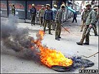 Police at the scene of protests in Srinagar