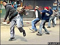 Protestors in Srinagar throw stones at the police