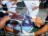 A seriously injured Thai teacher cries in pain on his way to hospital in Yala province, 3 February 2005.