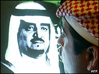 Man kissing TV screen showing King Fahd after announcement of his death