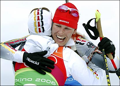 Kati Wilhelm is congratulated after helping Germany win the silver medal