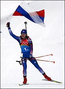 Albina Akhatova crosses the finish line to secure gold for Russia