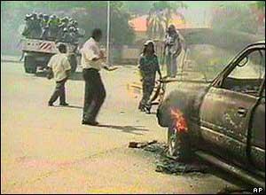 Police near burning car