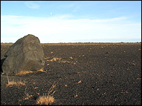 Large boulder on barren land (BBC)