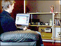 Image of a man at a laptop