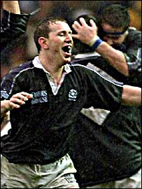 Former Scotland captain Andy Nicol celebrates victory over England in 2000
