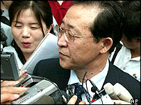 North Korea's Vice Foreign Minister Kim Kye Gwan is surrounded by reporters in front of the North Korean embassy in Beijing, China, on Tuesday August 2, 2005