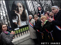 Ingrid Betancourt's picture hangs on the fence of France's Senate