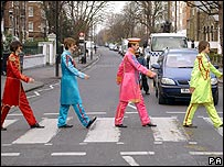 Actors imitating the cover of the Abbey Road album
