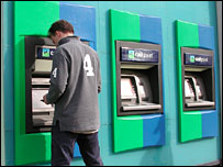 Lloyds customer using cash machine