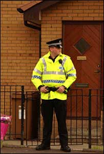 Officer at Kerry Muchan's house - Pic: Chris McNulty