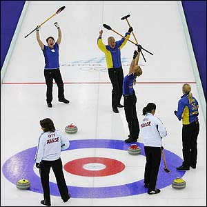 Sweden's players celebrate beating Switzerland in the women's curling final