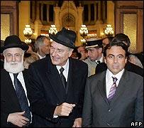 Jacques Chirac (C) at the service with Paris' great rabbi David Messas (L) and Paris consistory president Joel Mergui (R)