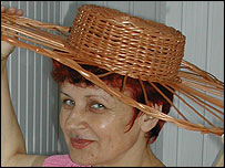 Wicker hat modelled by a woman from Rudnick on San, Poland