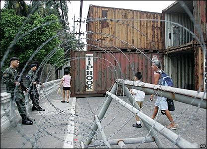 Shipping containers used as barricades outside the presidential palace
