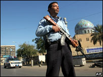 A soldier stands guard on an empty street outside a mosque in Iraq